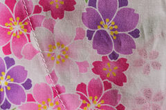 Colorful floral texture on cotton fabric. In horizontal frame Royalty Free Stock Image