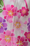 Colorful floral texture on cotton fabric. In vertical frame Royalty Free Stock Photos