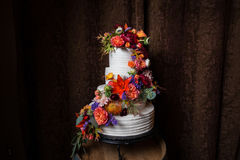 Colorful Floral on White Wedding Cake Stock Photography