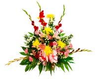 Colorful flower arrangement in basket Stock Images