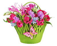 Colorful flower bouquet arrangement centerpiece in baby basket i Royalty Free Stock Images