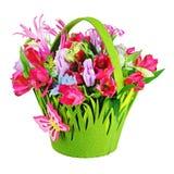 Colorful flower bouquet arrangement centerpiece in baby basket i Stock Image