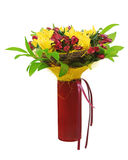 Colorful flower bouquet arrangement centerpiece in red vase. Royalty Free Stock Photos