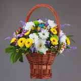 Colorful flower bouquet arrangement centerpiece in wicker basket Stock Photography