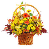 Colorful flower bouquet arrangement centerpiece in wicker basket Royalty Free Stock Image