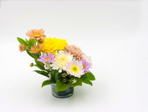 Colorful flower bouquet arrangement in vase isolated on white Stock Photography