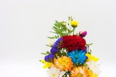 Colorful flower bouquet arrangement in vase  on white ba Stock Photos