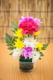 Colorful flower bouquet arrangement in vase Stock Photo