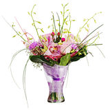 Colorful flower bouquet in glass vase isolated on white backgrou Stock Photo