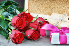Colorful flower bouquet from red roses and gift boxes Royalty Free Stock Photography