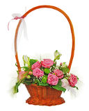 Colorful flower bouquet from roses in wicker basket  isolated on Stock Images