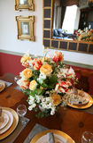 Colorful Flower Centerpiece. A colorful flower centerpiece on the dining room table Royalty Free Stock Photography