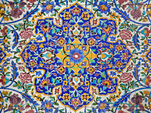 Colorful Flower Design Painted on Tiles. Floral design on the tiled wall of an old mosque in Tehran, Iran royalty free stock photography