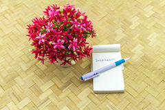Colorful flower Drunen sailor in vase and paper note with word I. NSPIRATION on bamboo weave background Stock Photos