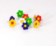 Colorful flower push. Pins against a soft background Stock Photos