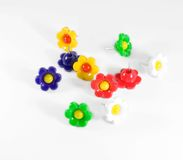 Colorful flower push pins against Stock Image
