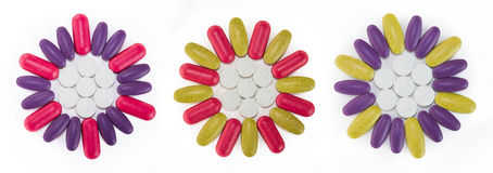 Colorful flower shaped pills Royalty Free Stock Photography