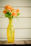 Colorful flower in transparent yellow vase Royalty Free Stock Photos