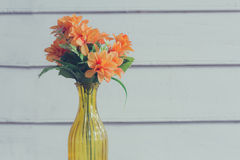 Colorful flower in transparent yellow vase Stock Photography