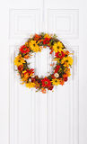 Flower wreath hanging on door Stock Images