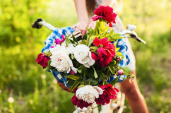 Colorful flowers in bicycle basket Stock Photo