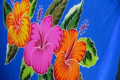 Colorful flowers on a blue towel Stock Images