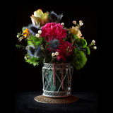 Colorful Flowers Bouquet. Bunch of flowers in a pot on black background Stock Image