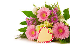 Colorful flowers bouquet  and heart shaped card. Royalty Free Stock Photos