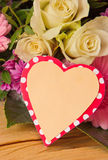 Colorful flowers bouquet  and heart shaped card. Stock Photography