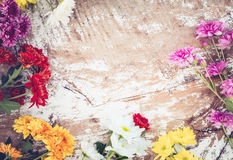Colorful flowers bouquet on vintage wooden background, Royalty Free Stock Photos