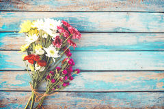 Colorful flowers bouquet on vintage wooden background, Royalty Free Stock Images