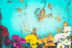Colorful flowers bouquet on vintage wooden background Stock Image