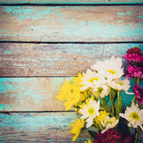 Colorful flowers bouquet on vintage wooden background, Stock Photography