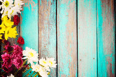 Colorful flowers bouquet on vintage wooden background, Royalty Free Stock Photography