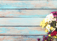 Colorful flowers bouquet on vintage wooden background, Royalty Free Stock Photo