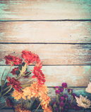 Colorful flowers bouquet on vintage wooden background, Stock Images