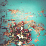 Colorful flowers bouquet on vintage wooden background Stock Photography
