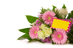 Colorful flowers bouquet  and yellow  card. Royalty Free Stock Image