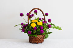 Colorful flowers in brown basket Royalty Free Stock Image