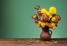 Colorful flowers in a ceramic vase Stock Photos