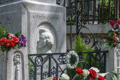 Colorful flowers on Chopin`s grave at Pere Lachaise Cemetery. stock image