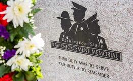 Colorful flowers frame a law enforcement memorial stock photos