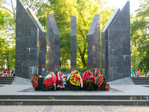Colorful flowers at the front of WW2 monuments Stock Image