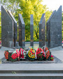 Colorful flowers at the front of WW2 monuments Royalty Free Stock Photo