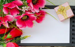 Colorful flowers and gift box on open book Royalty Free Stock Photo