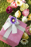 Colorful flowers with gift Stock Photos