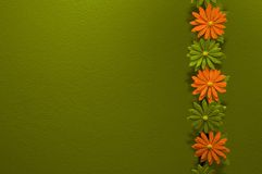 Colorful flowers and green wall. Flowers and bamboo with green background Royalty Free Stock Image