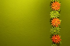Colorful flowers and green wall. Flowers and bamboo with green background Stock Images