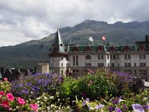 Colorful flowers and historical building in european alpine St. Moritz city center in Switzerland. Colorful flowers and historical building in european city royalty free stock image