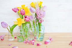 Colorful flowers in little bottles Royalty Free Stock Images